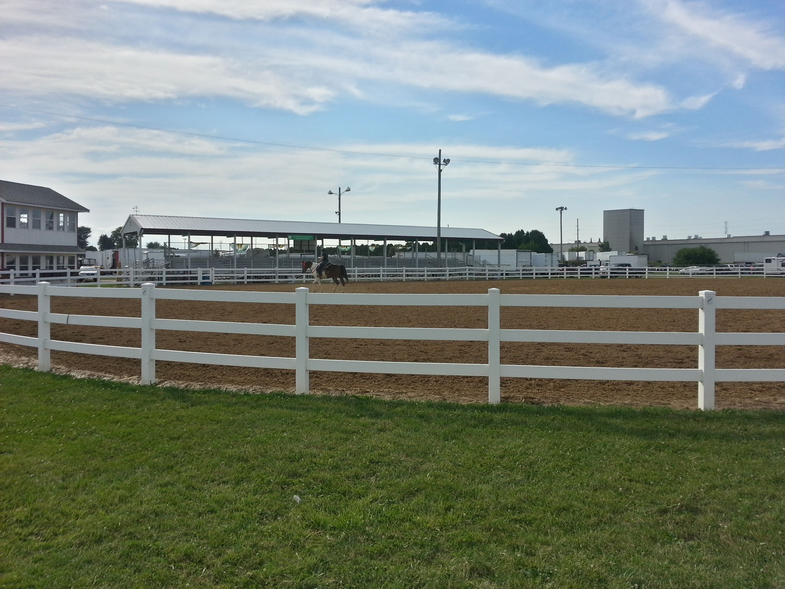 Horse riding arena with bleacher seating area in the background